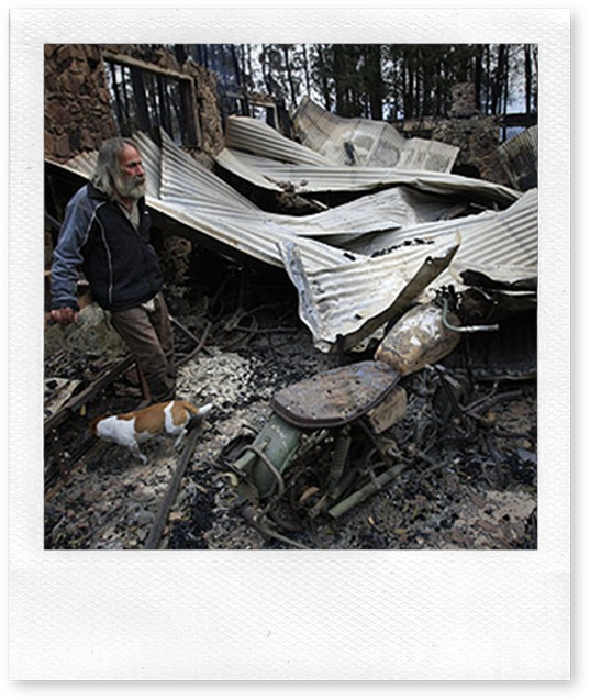 Rob Hallet stands amoung his shed that contained a rare collection of BSA motorbikes and antique guns, after the Narbethong fires.
